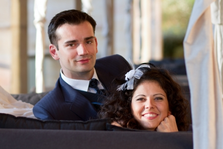 Young couple posing after their wedding photo