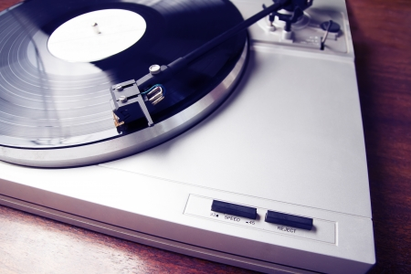 Turntable player with musical vinyl record. Useful for DJ, nightclub and retro theme. photo