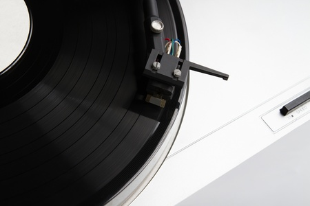 Turntable player with musical vinyl record  Useful for DJ, nightclub and retro theme  photo