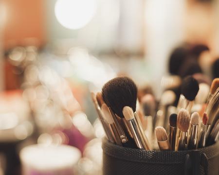 visagiste: Close up of professional visagist brushes for doing a make up. Fading film colors
