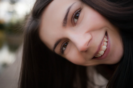 pug nose: Portrait of funny young girl with pug nose and cheerful toothy smile, friendly facial expression.