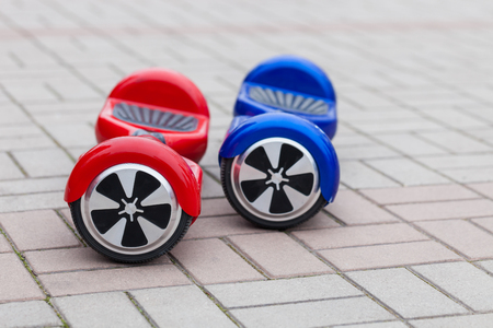 hover: Modern transportation technology - electric mini segway scooter hover board. Easy and fun way to ride the city streets. Trending new gadget that became very popular among youth and adults. This is the future of energy effetive personal urban transport tha Stock Photo