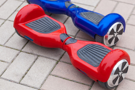 hover: Modern transportation technology - electric mini segway or scooter hover board. Easy and fun way to ride the city streets on electric power. This is the future of energy effetive personal urban transport that produces no air pollution at all