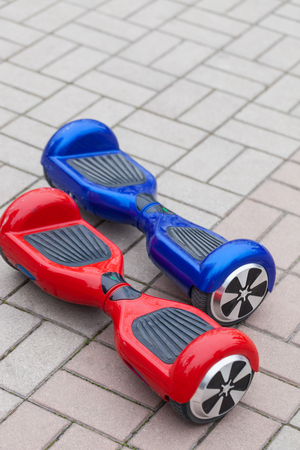 hover: Modern transportation technology - electric mini segway or scooter hover board. Trending new gadget that became very popular among youth and adults. This is the future of energy effetive personal urban transport that produces no pollution to the atmospher