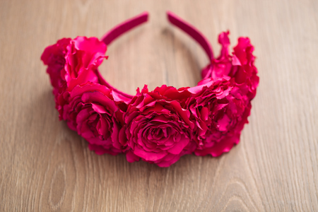 wraith: Handmade wraith made of artificial pink rose flowers on a wooden background. Shallow depth of field, macro close up photo, no models