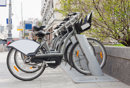 shared sharing: Rental bike pickup location in the city. Great way to take bicycle for a ride for cheap. Pay with credit card and use terminal computer on handlebar to take the parked vehicle. Easy and healthy urban transport technology