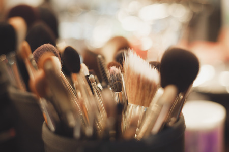 Main tools of professional visage studio - set of different brushes of any size for facial make up. Fading film colors