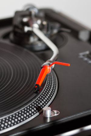 vinyl records: Professional turntable playing vinyl records with music.