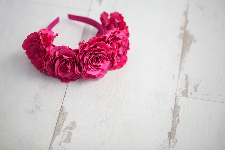 wraith: Handmade wraith made of artificial pink rose flowers on a wooden background.