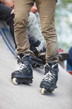 inline skater: Aggressive inline skater on rollerskate standing on ramp. Stock Photo