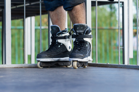 inline: Aggressive inline skates for extreme tricks in focus. Stock Photo