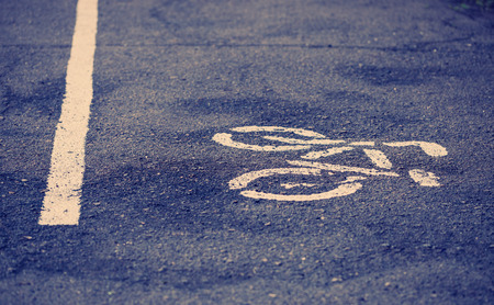 straight line: White symbol of bicycle and straight line showing the direction of traffic.