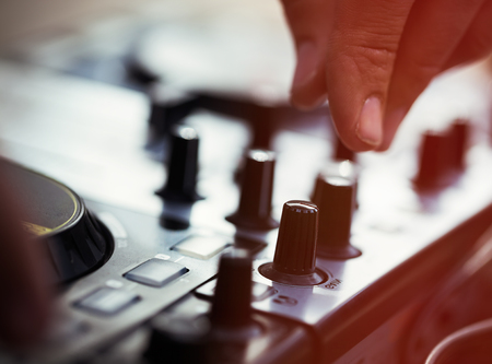 midi: Dj playing music on modern midi controller turntable.