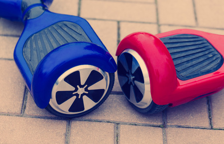 hover: Modern transportation technology - electric mini scooter hover board. Stock Photo