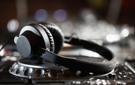 jockey: Headphones on CD music disc player for DJ.