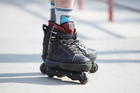 inline skater: Aggressive inline skates on roller skater feet. Stock Photo