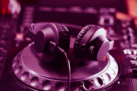 disc jockey: Headphones on CD music disc player for DJ. Top class audio equipment for studio,event,concert. Widely used by professional disc jockey. Macro, close up