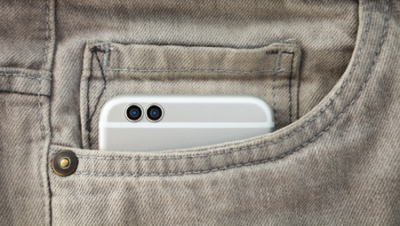 megapixel: Modern futuristic dual stereo camera mobile phone in jeans pocket. New technology that will be popular tomorrow