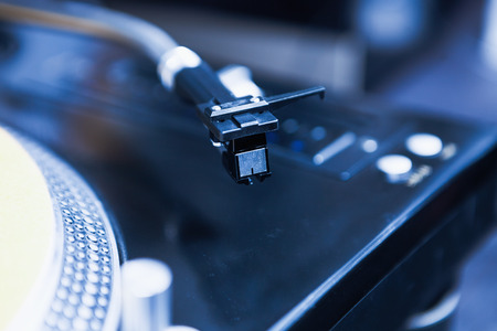 Turntable needle cartridge close up.Professional DJ audio equipment for disc jockey to play music on hip hop party,concert,event. Stock Photo