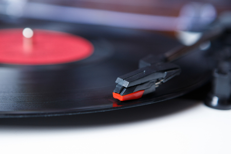 Retro hipster music player.Vintage electronic device for listening vinyl records Stock Photo