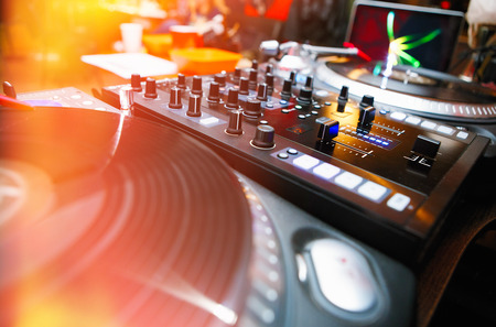 Professional dj turntable player and sound mixer controller Stock Photo