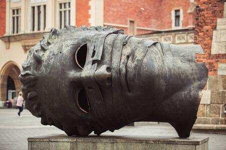 KRAKOW,POLAND-23 APRIL,2019: Famous Eros Bound sculpture in center of historic European town Krakow in central Poland. Editorial
