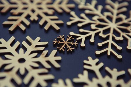 Rustic wooden snowflakes for Christmas Eve celebration.Hand made crafts for New Year home decor.Decorate house with eco friendly materials for winter holidays