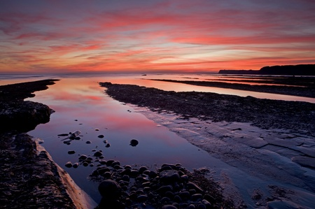 kimmeridge: Sunset over Kimmeridge Bay, Dorset Stock Photo