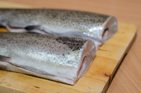 rainbow fish: Baked fish Rainbow Trout Stuffed on a wood cutting board