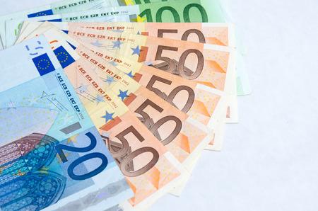 stylized banking: Stack of Euro banknotes isolated white background Stock Photo