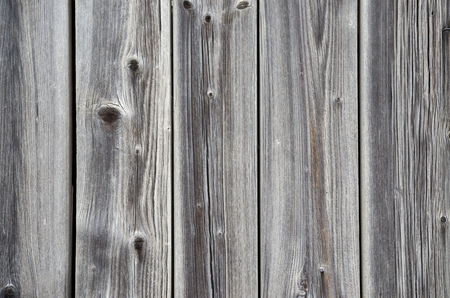 furniture part: Wooden striped fiber textured background. High quality wood fence with knots. Close up brown grainy surface wood texture of parquet or part of furniture. Old grunge panel.