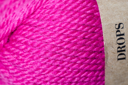cable stitch: Close up macro pink knitting wool texture. Part of clothing textile.
