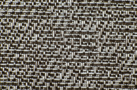 cotton carbon fiber: Perforated black textile pattern from audio speaker. Background or backdrop texture.