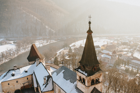 nosferatu: Aerial view of Oravsky Podzamok from Orava Castle in Slovakia. Old medieval tower. Beautiful winter landscape with sunshine.