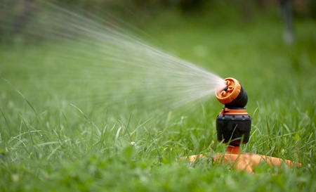 sprinkle system: sprinklers for the grass in the yard Stock Photo