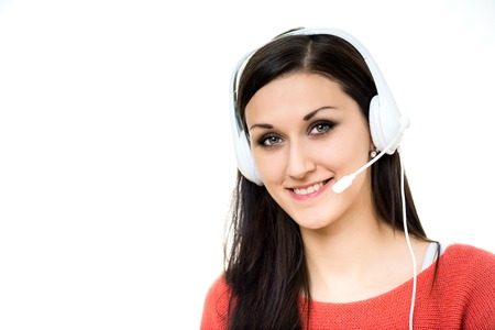 communicates: girl communicates with clients via the Internet or by telephone as dispatcher Stock Photo