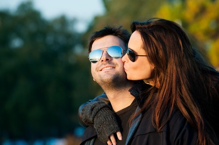 man woman hugging: young couple in love Stock Photo