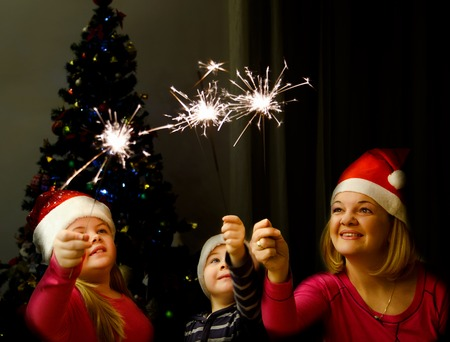 sparklers: Sparklers and New Year with kids Stock Photo