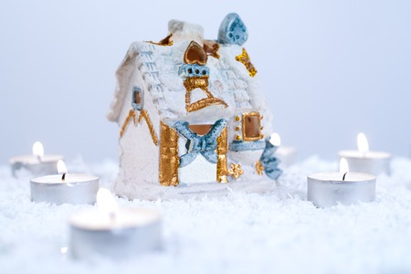 snow house: Christmas decoration with artificial snow, snow house and candles
