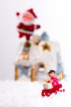 snow house: Christmas decoration with artificial snow, snow house, Santa Claus and angels in a sleigh Stock Photo