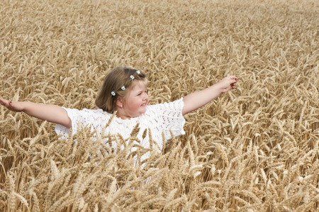 little girl in the wheat
