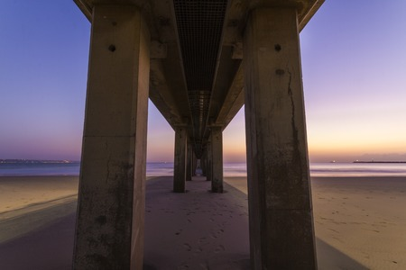 underbelly: A view from the underbelly of the Addington Pier Stock Photo