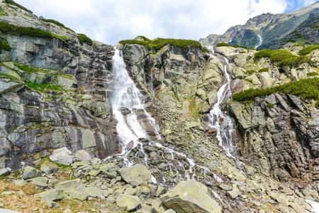 waterfall with sky: Leap waterfall, High Tatras in Slovakia