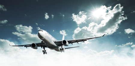 Airplane above the clouds Standard-Bild