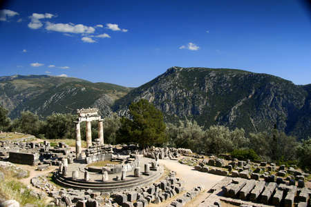 delphi: Delphi, Tholos (Greece) at late afternoon with clouds.