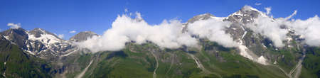 merged: Mountain panorama with clouds, frosen snow. Ive merged some photos to make this photo.