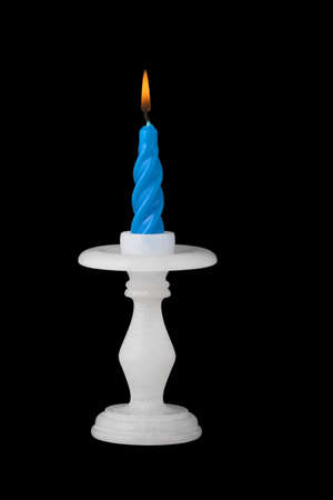 contentedness: Candlestick with flaming candle.