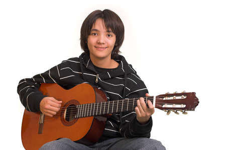 a guitarist boy playing guitar: Smiling boy playing guitar on white background Stock Photo