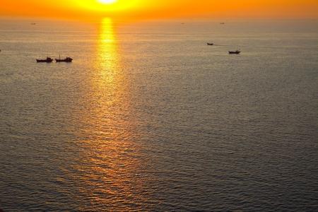 Beautiful golden sunrise at sea