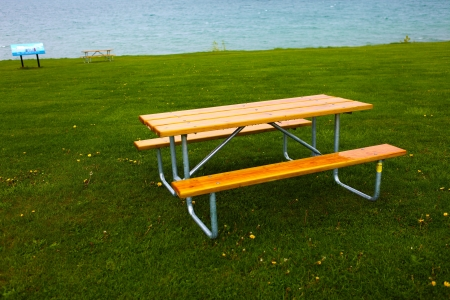 Wooden tables and lawn photo